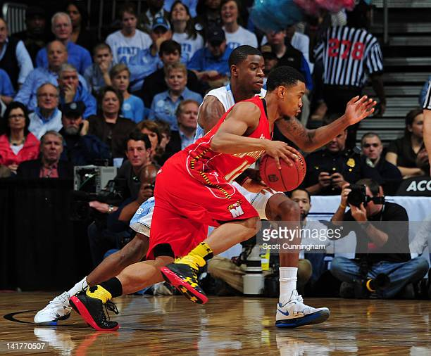 Terrell Stoglin of the Maryland Terrapins drives against Reggie Bullock of the North Carolina Tar Heels during the quarterfinals of 2012 ACC Men's...