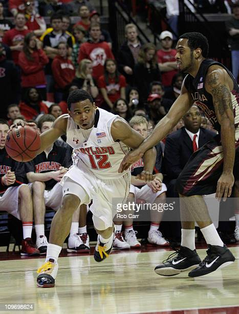 Terrell Stoglin of the Maryland Terrapins drives against the defense of Derwin Kitchen of the Florida State Seminoles at the Comast Center February...