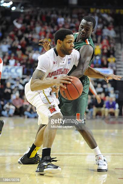 Terrell Stoglin of the Maryland Terrapins fights to hold on to the ball during a college basketball game against Durand Scott of the Miami Hurricanes...