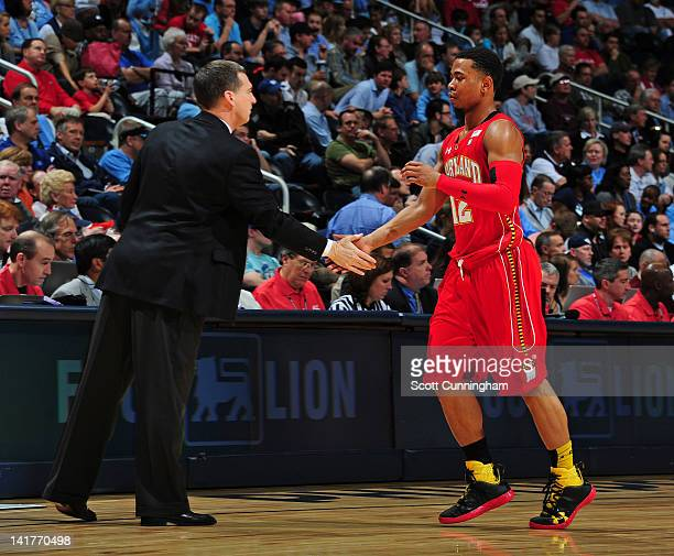 Terrell Stoglin of the Maryland Terrapins is greeted by Head Coach Mark Turgeon in the game against the North Carolina Tar Heels during the...