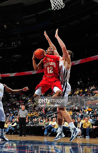 Terrell Stoglin of the Maryland Terrapins puts up a shot against Daniel Miller of the Georgia Tech Yellow Jackets at Philips Arena on February 25...