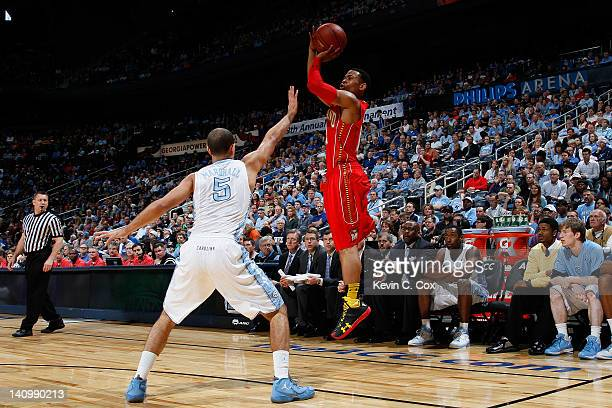 Terrell Stoglin of the Maryland Terrapins shoots over Kendall Marshall of the North Carolina Tar Heels in the first half during the Quarterfinals of...