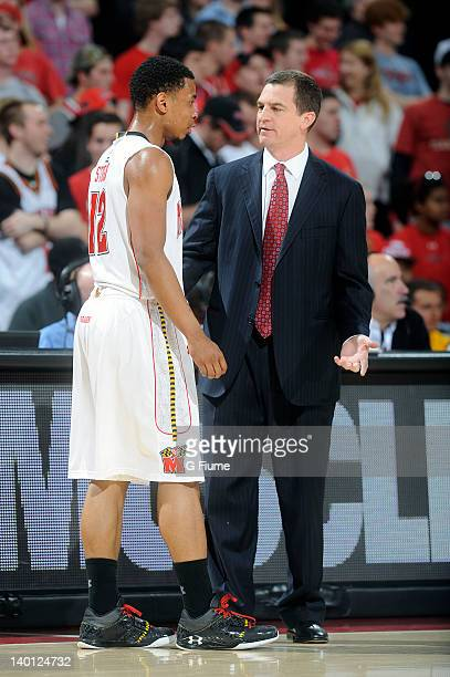 Terrell Stoglin of the Maryland Terrapins talks with head coach Mark Turgeon during the game against the Miami Hurricanes at the Comcast Center on...