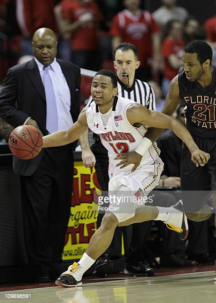 Terrell Stoglin#12 of the Maryland Terrapins dribbles around Michael Snaer of the Florida State Seminoles at the Comast Center on February 23 2011 in...