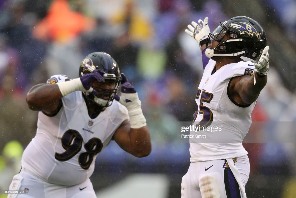 Terrell Suggs #55 and Brandon Williams #98 of the Baltimore Ravens celebrate after a sack in the second quarter against the Buffalo Bills at M&T Bank Stadium on September 9, 2018 in Baltimore, Maryland.
