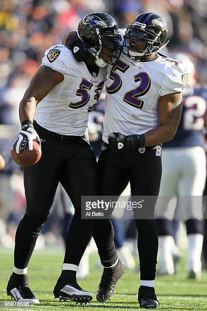 Terrell Suggs and Ray Lewis of the Baltimore Ravens celebrate after Suggs recovered his own forced fumble in the first quarter against the New...