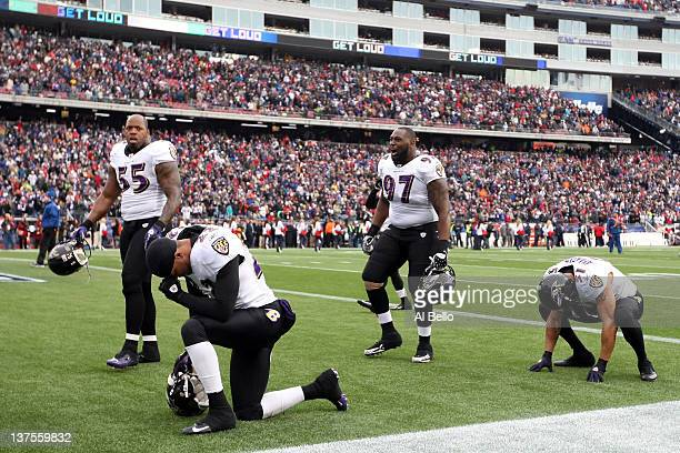 Terrell Suggs Arthur Jones Brendon Ayanbadejo and Jimmy Smith of the Baltimore Ravens prepare before playing against the New England Patriots during...