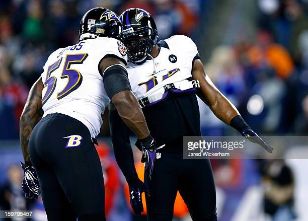 Terrell Suggs of the Baltimore Ravens and teammate Ray Lewis warm up prior to the 2013 AFC Championship game against the New England Patriots at...