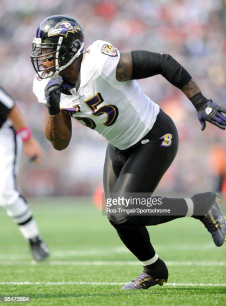 Terrell Suggs of the Baltimore Ravens defends against the New England Patriots at Gillette Stadium on October 4 2009 in Foxboro Massachusetts The...