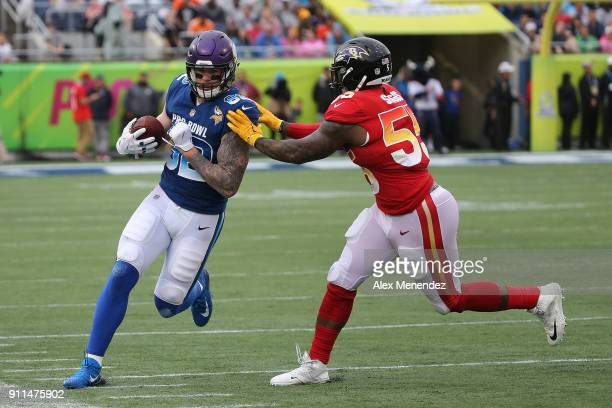 Terrell Suggs of the Baltimore Ravens pushes Kyle Rudolph of the Minnesota Vikings out of bounds during the NFL Pro Bowl between the AFC and NFC at...