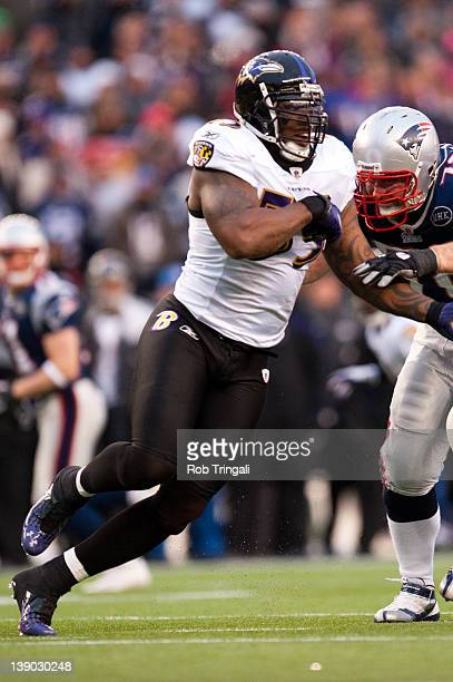Terrell Suggs of the Baltimore ravens rushes the passer against the New England Patriots during the AFC Championship Game at Gillette Stadium on...