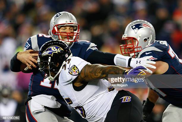 Terrell Suggs of the Baltimore Ravens sacks Tom Brady of the New England Patriots during the first quarter of the 2014 AFC Divisional Playoffs game...