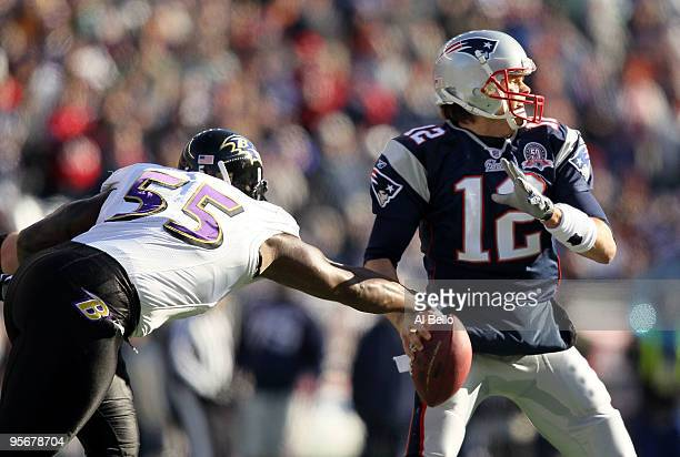 Terrell Suggs of the Baltimore Ravens stripes the ball from Tom Brady of the New England Patriots during the first quarter of the 2010 AFC wildcard...