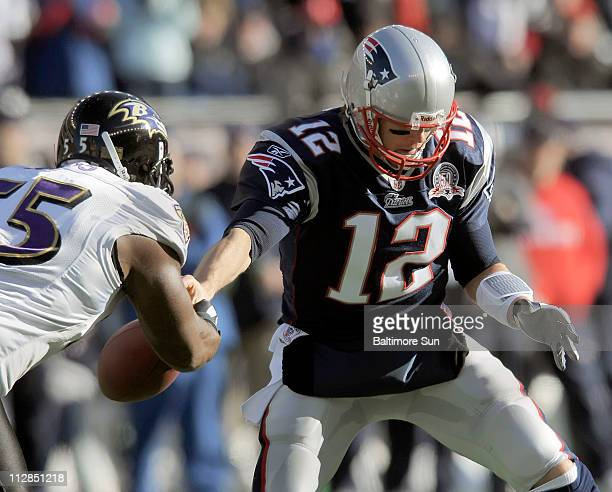Terrell Suggs of the Baltimore Ravens strips the ball from quarterback Tom Brady of the New England Patriots in their AFC Wild Card playoff game on...