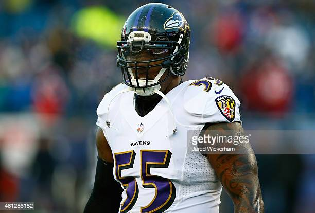 Terrell Suggs of the Baltimore Ravens warms up before the 2014 AFC Divisional Playoffs game against the New England Patriots at Gillette Stadium on...
