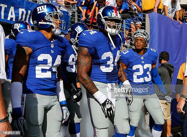 Terrell Thomas Brandon Jacobs and Corey Webster of the New York Giants prepare to play against the Denver Broncos on September 15 2013 at MetLife...