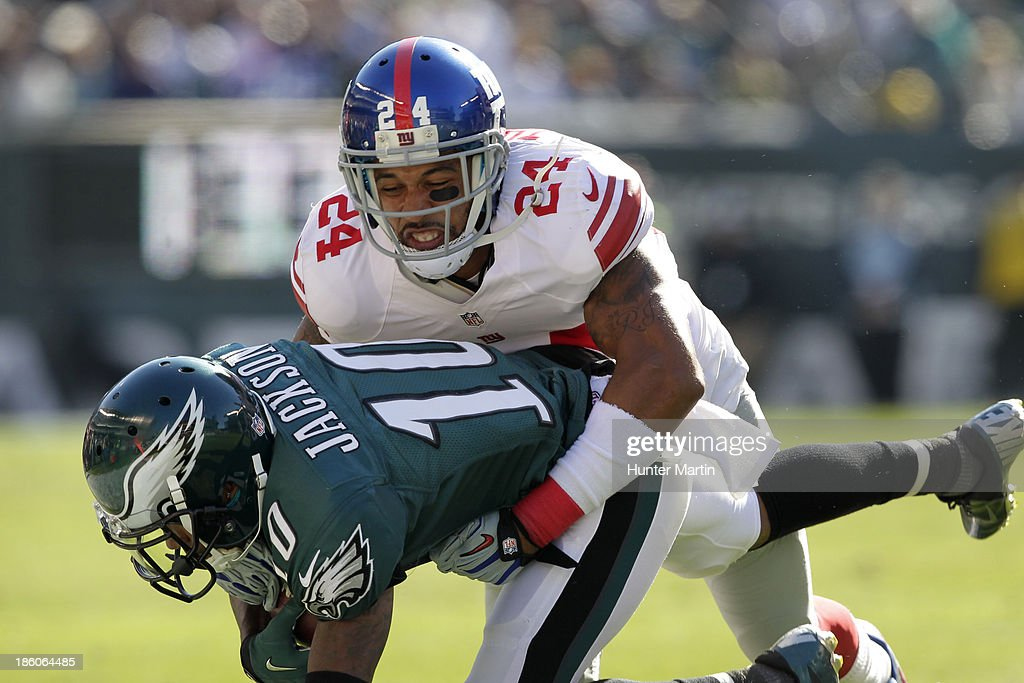 Terrell Thomas #24 of the New York Giants tackles DeSean Jackson #10 of the Philadelphia Eagles during a game on October 27, 2013 at Lincoln Financial Field in Philadelphia, Pennsylvania. The Giants won 15-7.
