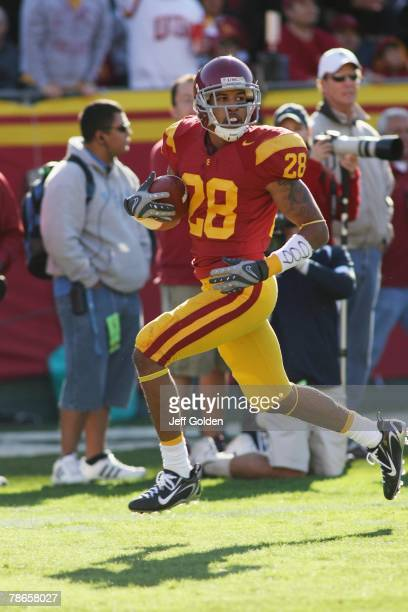 Terrell Thomas of the USC Trojans returns an interception zero yards against the UCLA Bruins in the third quarter of the game on December 1, 2007 at...