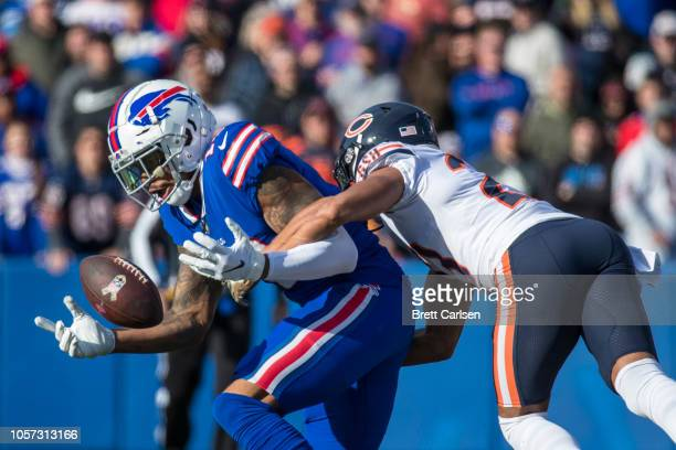 Terrelle Pryor of the Buffalo Bills bobbles a pass as he is tackled by Kyle Fuller of the Chicago Bears Adrian Amos intercepted the pass during the...