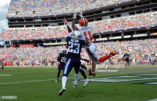 Terrelle Pryor of the Cleveland Browns catches a touchdown pass over Brice McCain of the Tennessee Titans during the first half at Nissan Stadium on...