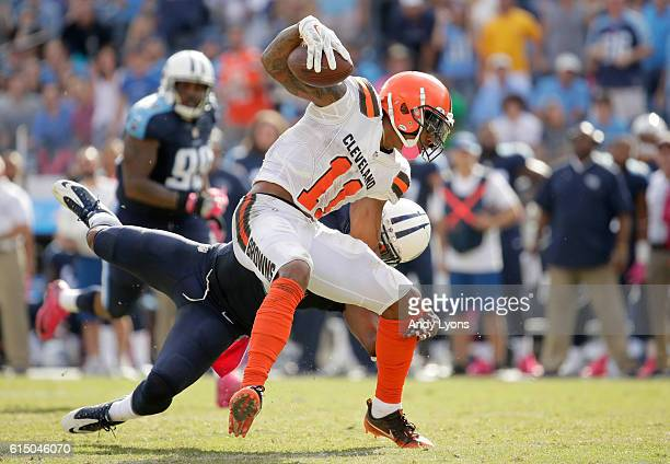Terrelle Pryor of the Cleveland Browns runs with the ball while defended by Daimion Stafford of the Tennessee Titans at Nissan Stadium on October 16...