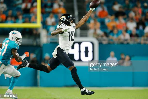 Terrelle Pryor of the Jacksonville Jaguars makes a catch against the Miami Dolphins during the second quarter of the preseason game at Hard Rock...