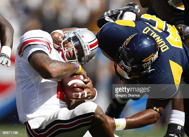 Terrelle Pryor of the Ohio State Buckeyes gets tackled by Archie Donald of the Toledeo Rockets on September 19 2009 at Cleveland Browns Stadium in...