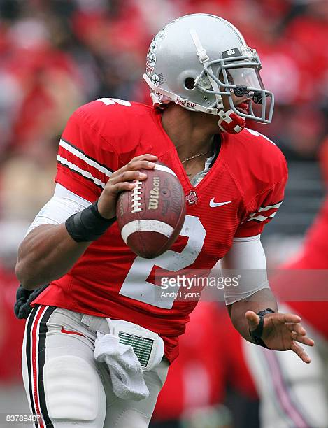 Terrelle Pryor of the Ohio State Buckeyes looks to pass the ball during the Big Ten Conference game against the Michigan Wolverines at Ohio Stadium...