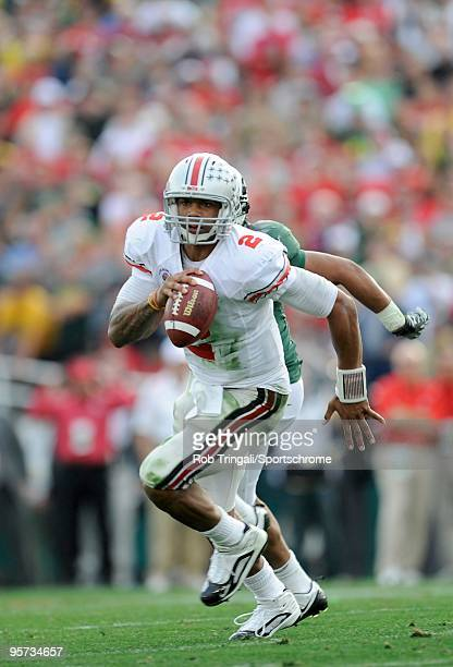 Terrelle Pryor of the Ohio State Buckeyes scrambles against the Oregon Ducks in the 96th Rose Bowl played on January 1 2010 in Pasadena California...