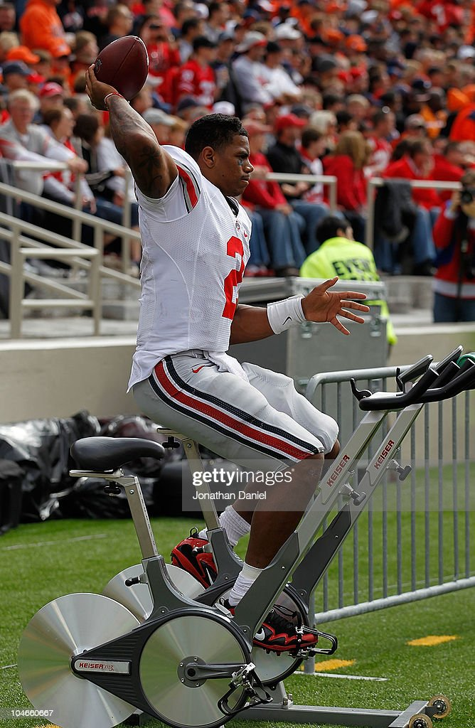 Terrelle Pryor #2 of the Ohio State Buckeyes throws a football while riding an exercise bicycle on the sidelines after suffering a leg injury against the Illinois Fighting Illini at Memorial Stadium on October 2, 2010 in Champaign, Illinois. Ohio State defeated Illinois 24-13.