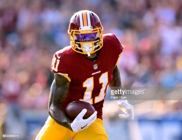 Terrelle Pryor of the Washington Redskins runs after his catch during the game against the Los Angeles Rams at Los Angeles Memorial Coliseum on...