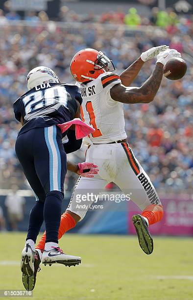 Terrelle Pryor Sr #11 of the Cleveland Browns attempts to make a catch while being guarded by Perrish Cox of the Tennessee Titans during the first...