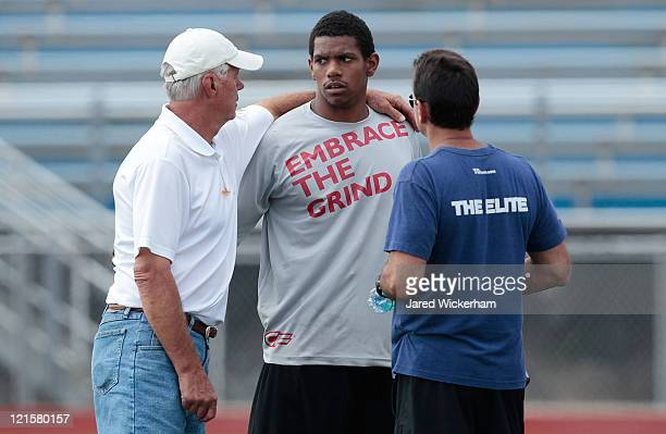 Terrelle Pryor talks to quarterbacks coach Ken Anderson and agent Drew Rosenhaus prior to his pro day at a practice facility on August 20, 2011 in...
