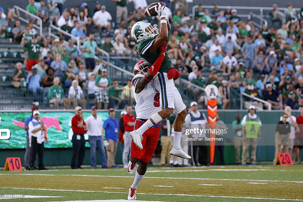 Terren Encalade #5 of the Tulane Green Wave catches a touchdown over Horace Richardson #9 of the Southern Methodist Mustangs during the second half of a game at Yulman Stadium on October 29, 2016 in New Orleans, Louisiana.