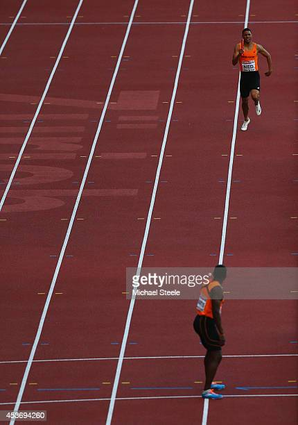 Terrence Agard of the Netherlands prepares to hand over to Obed Martis in a rerun of the Mens 4x400m heat during the 22nd European Athletic...