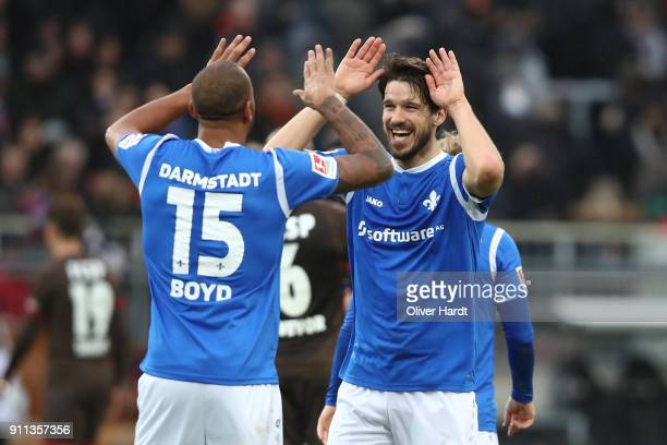 Terrence Boyd and Romain Bregerie of Darmstadt celebrate after the Second Bundesliga match between FC St Pauli and SV Darmstadt 98 at Millerntor...