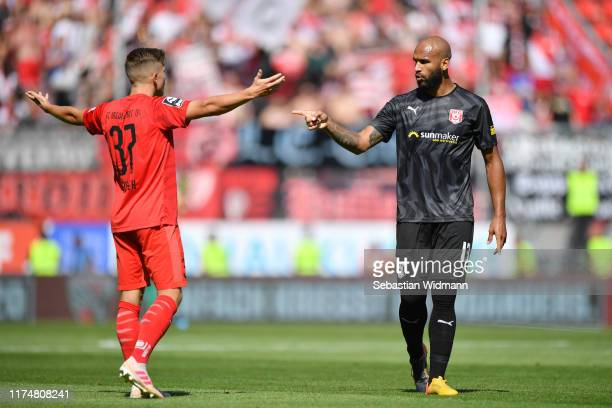 Terrence Boyd of Hallescher FC gestures towards Patrick Sussek of Ingolstadt during the 3. Liga match between FC Ingolstadt and Hallescher FC at Audi...