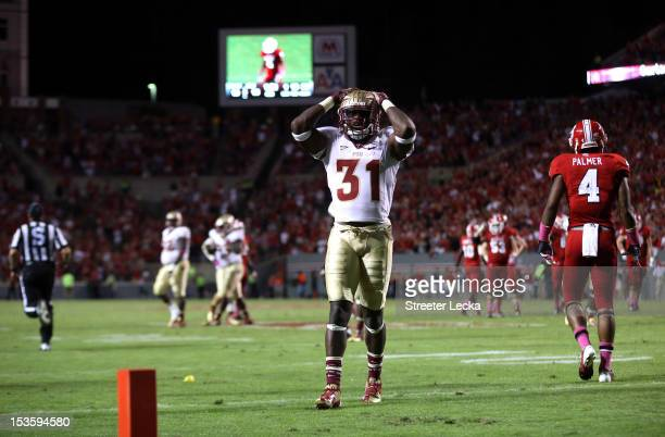 Terrence Brooks of the Florida State Seminoles reacts to a play against the North Carolina State Wolfpack during their game at CarterFinley Stadium...