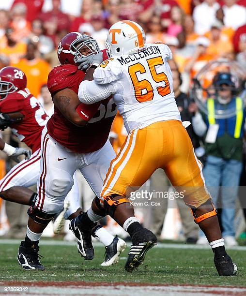 Terrence Cody of the Alabama Crimson Tide against Jacques McClendon of the Tennessee Volunteers at BryantDenny Stadium on October 24 2009 in...