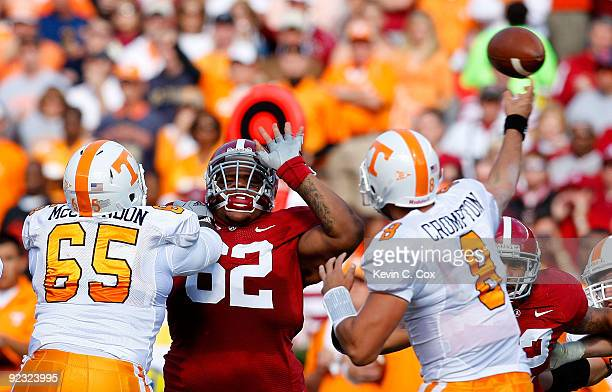 Terrence Cody of the Alabama Crimson Tide pushes into the backfield against Jacques McClendon of the Tennessee Volunteers in front of quarterback...