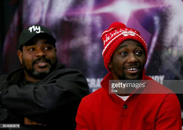 Terrence Crawford looks on as Hank Lundy speaks during a press conference at Madison Square Garden on January 12 2016 in New York CityCrawford will...