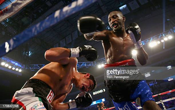 Terrence Crawford tries to connect a right with the face of Alenjandro Sanabria in the second round during their NABO Lightweight Titl bout at the...
