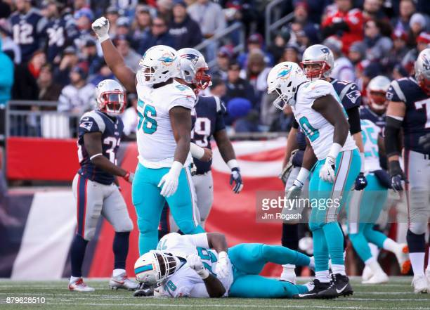Terrence Fede of the Miami Dolphins is injured during the second quarter of a game against the New England Patriots at Gillette Stadium on November...