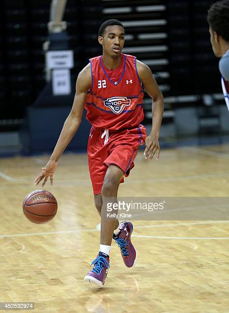 Terrence Ferguson in red brings the ball up the court during the National Basketball Players Association Top 100 Camp on June 17 2014 at John Paul...
