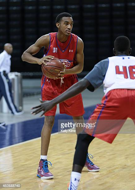 Terrence Ferguson in red looks to pass the ball up the court during the National Basketball Players Association Top 100 Camp on June 17 2014 at John...