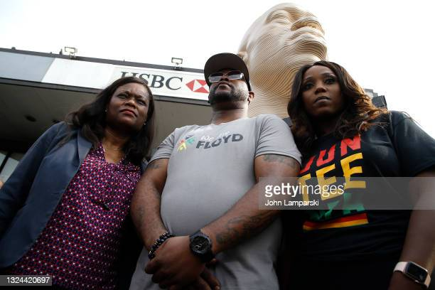 Terrence Floyd and Councilwoman Farrah Louis stand near his brothers statue during the unveiling of the George Floyd memorial as New York City Honors...