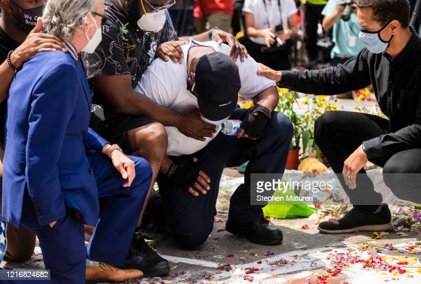 Terrence Floyd falls to his knees at the site where his brother George Floyd was killed by police one week ago on June 1 2020 in Minneapolis...