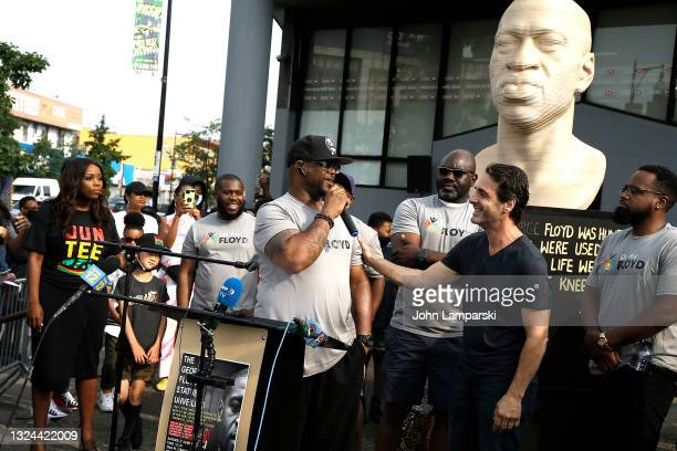 Terrence Floyd speaks to artist Chris Carnabuchi during the unveiling of his brothers statue, George Floyd as New York City Honors Juneteenth Holiday...