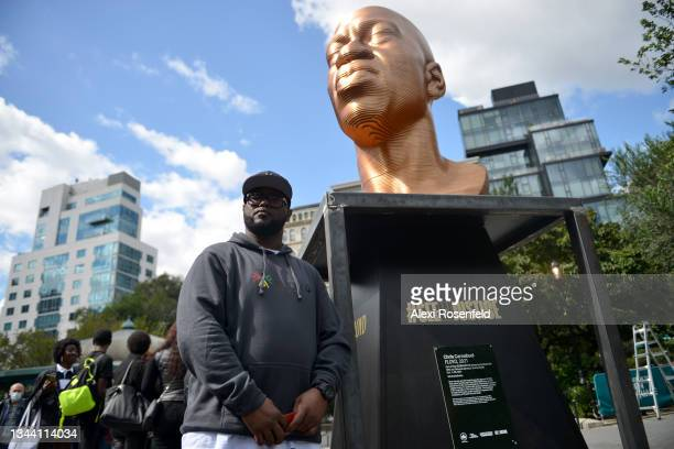 """Terrence Floyd stands in front of the """"Floyd"""" sculpture during Confront Art's First Exhibition launch SEEINJUSTICEin Union Square on September 30,..."""