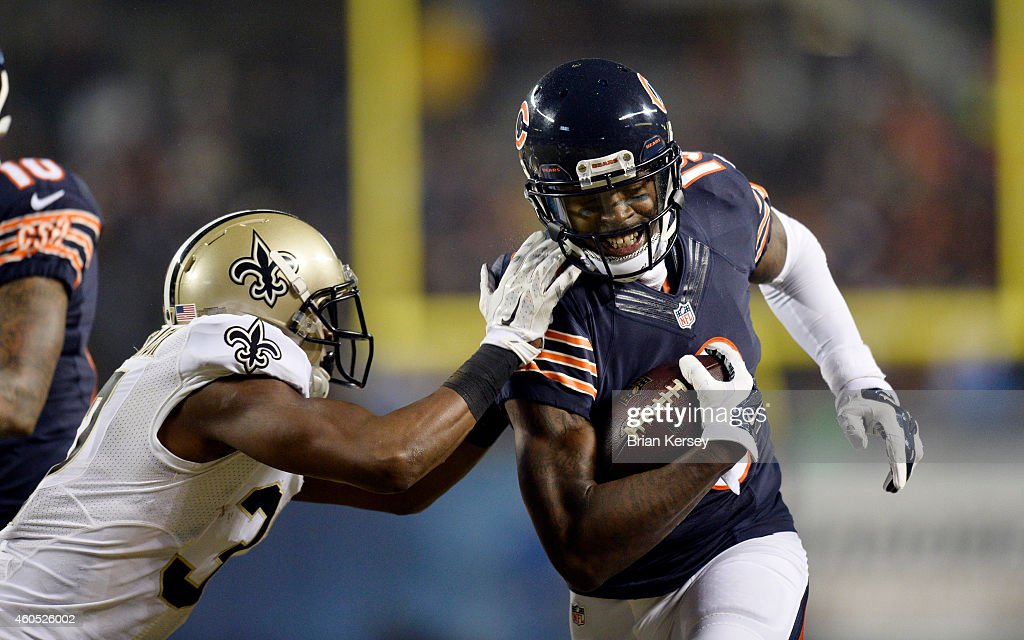 Terrence Frederick #37 of the New Orleans Saints forces Josh Morgan #19 of the Chicago Bears out of bounds after a reception during the fourth quarter at Soldier Field on December 15, 2014 in Chicago, Illinois. The Saints defeated the Bears 31-15.